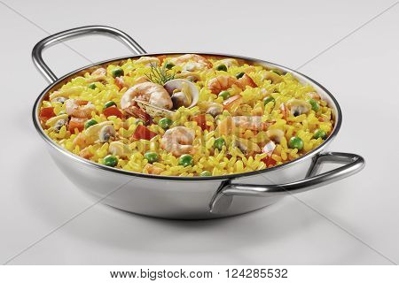 Small paella in a pan on white plane