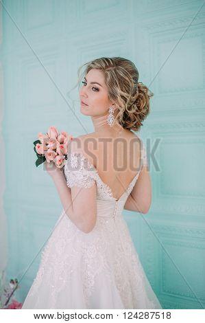 Portrait Of Bride In Flower Decor, Studio Photo. Beautiful Bride Portrait Wedding Makeup And Hairsty