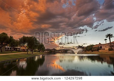 Marguerite Lake along the greenbelt in Scottsdale Arizona at sunset with Camelback Mountain in the distant background.