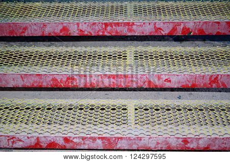 Red and yellow open design metal steps