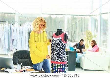 fashion- designer fashion designer working on a new model dress