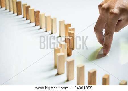 Finger like a business man and wooden block like reached an impasse Stalemate and solving a problem.