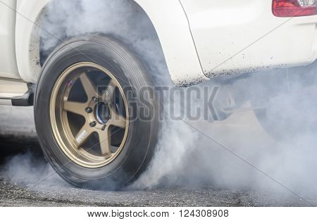 car burnout at a drag racing track