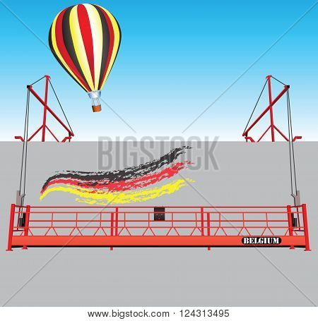 Industrial building wall with hoist and a balloon Belgium national flag colors.
