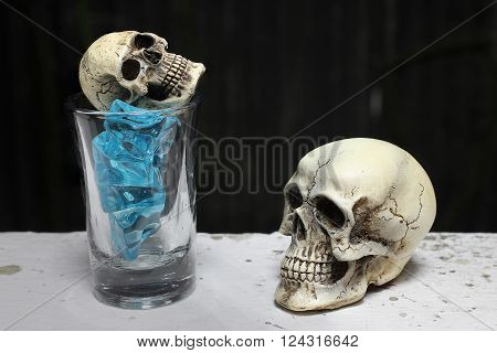 Skull With Blue Ice In Shot Glass. -still Life
