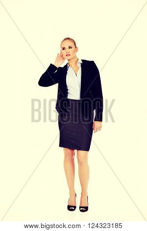 Young business woman overhears a conversation