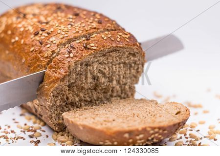 Seed Bread, A Slice Cut On White Background