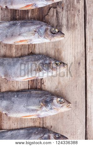 background of dried fish on the old wood Board closeup