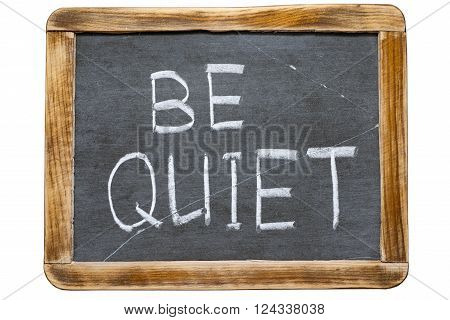 be quiet phrase handwritten on vintage school slate board isolated on white