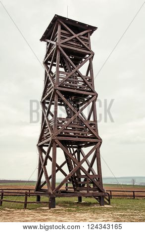 Big wooden lookout tower. Distant view. Beautiful place.