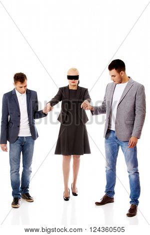 Business team-two men helping to blindfolded woman