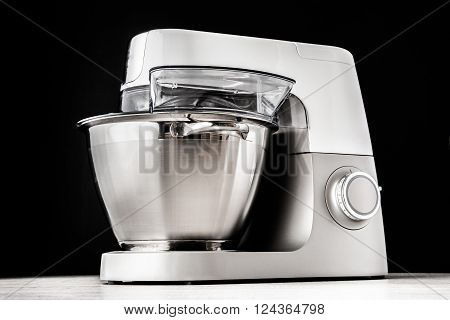 Food processor on the black background horizontal