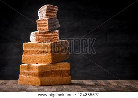 Pyramid of pastila pieces on the wooden table horizontal