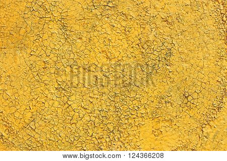 Shelled And Cracked Old Painted Yellow Surface