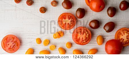 Tomatoes mix on the white table wide screen
