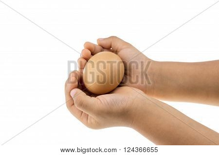 egg in hand of the childrent isolate on white background