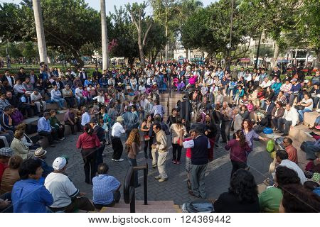 Lima, Peru - August 29, 2015: People at the public Saturday Salsa dancing event in Parque Kennedy in Miraflores district.
