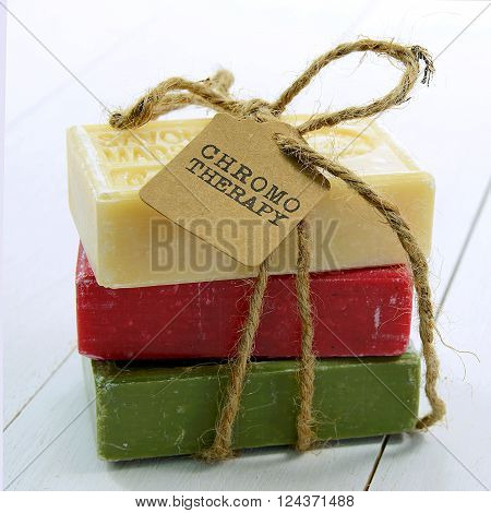 Spa setting with natural soaps and flower for aromatherapy
