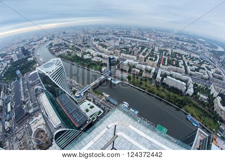 MOSCOW, RUSSIA - SEP 3, 2014: Futuristic Moscow International Business Center, river, Bagration bridge. Years of construction of complex - 1995-2018