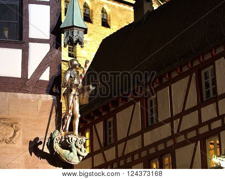 Nuremberg Germany - March 21 2016: A knight statue at a house corner at the medieval square at the Durer house at night