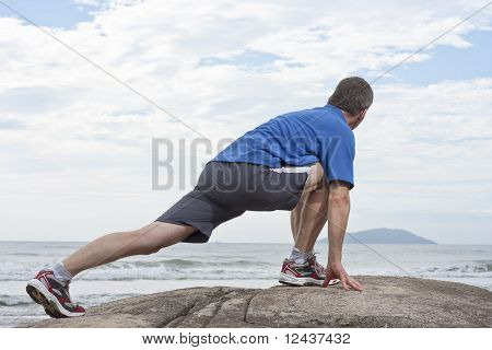 Runner Doing Stretching Exercise