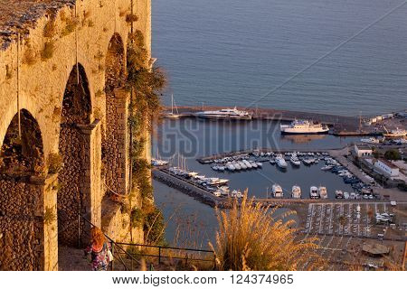 ruins of Temple of Jupiter Italy Terracina landscape marina of yacht