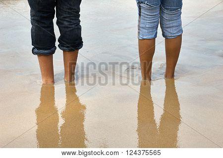 Bare feet in the sand on a beach