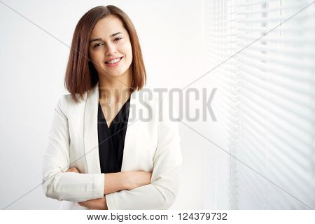 Business woman portrait. Crossed arms