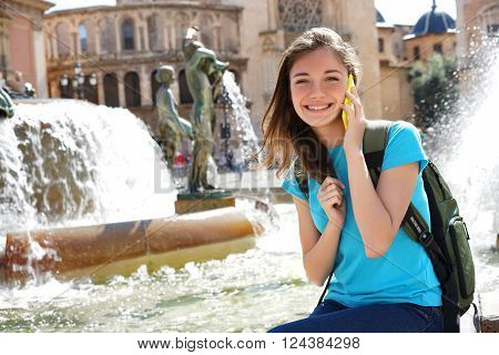 Travel tourist woman talking on smartphone and smiling in Valencia Spain. Travel and tourism concept.
