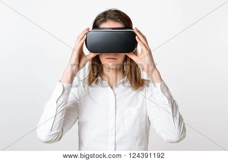 One Woman Holds Virtual Reality Glasses To Face
