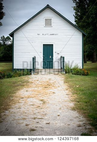 Small white building that at one time was a one room school house.