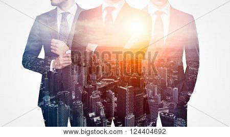 Photo of trio stylish adult businessman wearing trendy suit. Double exposure, panoramic view sunset contemporary city background. Man power, leadership, isolated on white.