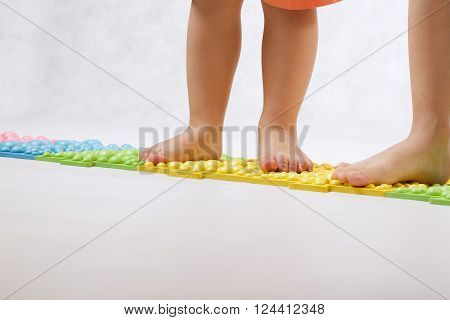 Childrens Feet On A Orthopaedic Mat