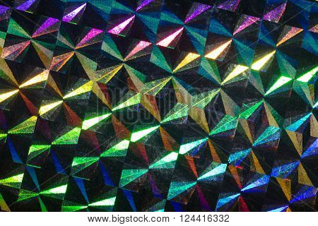 Psychedelic abstract formed by light reflecting off a textured metal surface