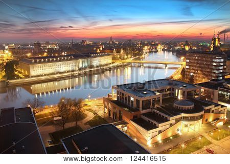 WROCLAW POLAND - APRIL 01 2016: Aerial view of Wroclaw. City skyline Churches on Ostrow Tumski island over Odra river during a beautiful sunset April 01 2016 in Wroclaw Poland.