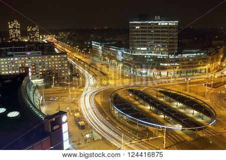 WROCLAW POLAND - MARCH 10 2016: Traffic roundabout shot with long exposure time at night Grunwaldzki Square March 10 2016 in Wroclaw Poland.