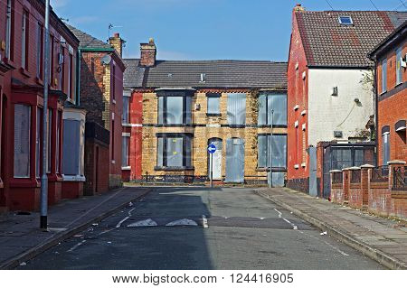A street of boarded up derelict houses awaiting regeneration in Liverpool UK