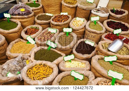 Close-up of different spices in bags to prepare delicious food. The counter on the Mahane Yehuda Market in Jerusalem, Israel.