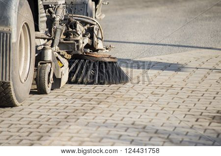 close up on Street sweeper machine cleaning the street