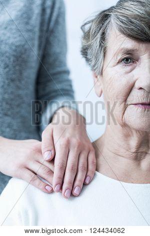 Photo of senior woman with schizophrenia having support