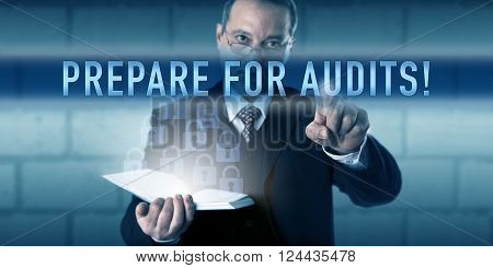 Security director is pushing PREPARE FOR AUDITS! on a virtual screen interface. Business challenge metaphor and information technology concept for audit-readiness under regulatory requirements.