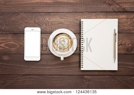 phone coffee and book blank on wood table top view