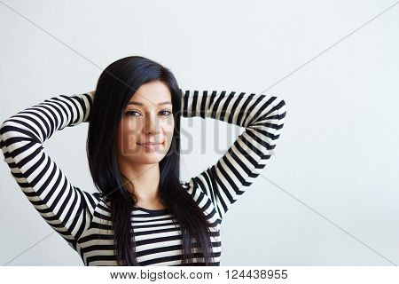 Beautiful Young Woman Sitting With Hands Behind Head