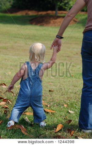 Little Girl Holding Hands With Mother