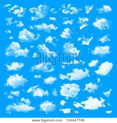 Set of multiple clouds and cloud formations isolated against the blue solid color background