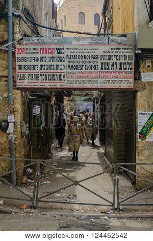 JERUSALEM ISRAEL - FEBRUARY 25 2016: Street scene with local orthodox Jews in the ultra-orthodox neighborhood Mea Shearim Jerusalem Israel