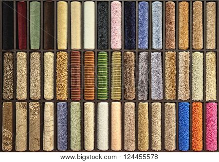 samples of multi-colored carpets on the shelves