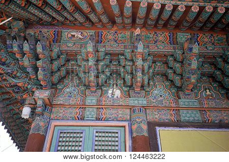 GYEONGJU CITY, NORTH GYEONGSANG PROVINCE / KOREA - CIRCA 1987: A view of the elaborately decorated eaves under a roof at the Bulguksa Buddhist Temple.