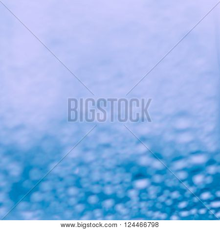 Abstract image of blue water condensation on glass