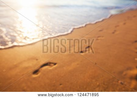 Blurred background of footprints at sunset time